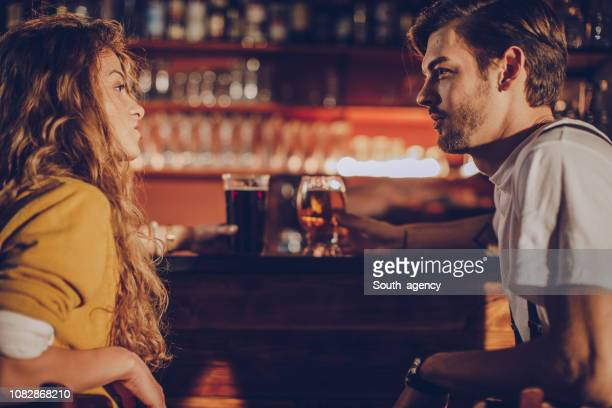 couple on date in pub - flirting stock pictures, royalty-free photos & images