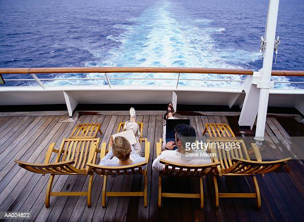 Couple on Deck Chairs of Cruise Ship, Caribbean