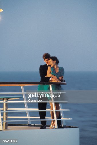Couple On Deck Of Cruise Ship Stock Photo