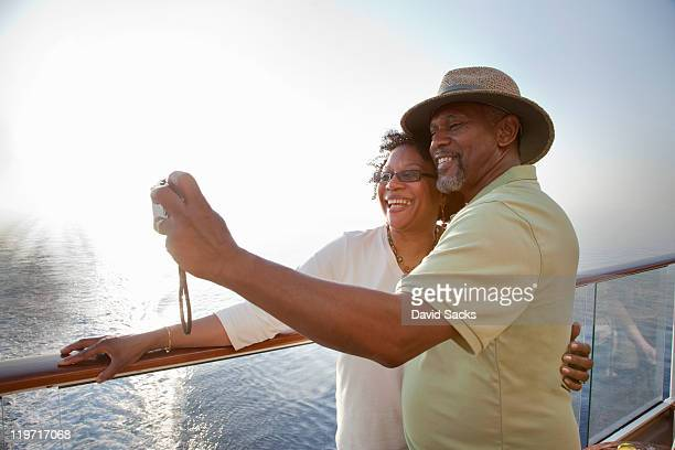 Couple on deck taking picture