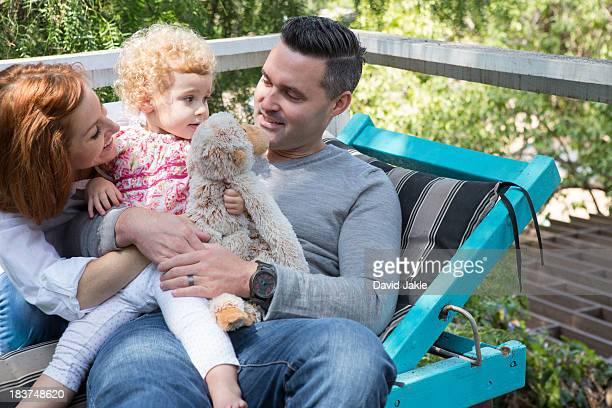 Couple on deckchair with child