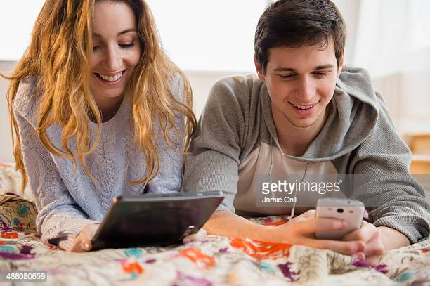 Couple on digital tablet and phone