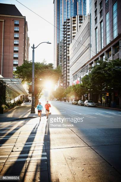 Couple on early morning run on city street