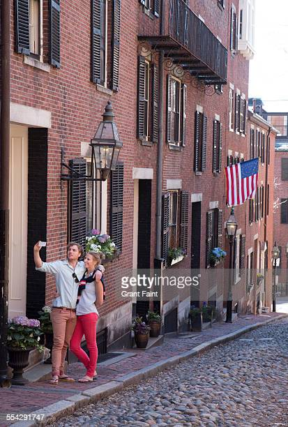 couple on famous street - acorn street boston stock pictures, royalty-free photos & images