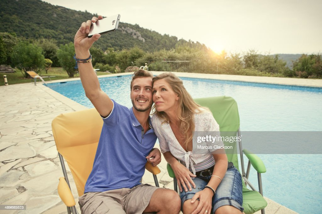 Couple on Holiday taking a selfie in france : Stock Photo