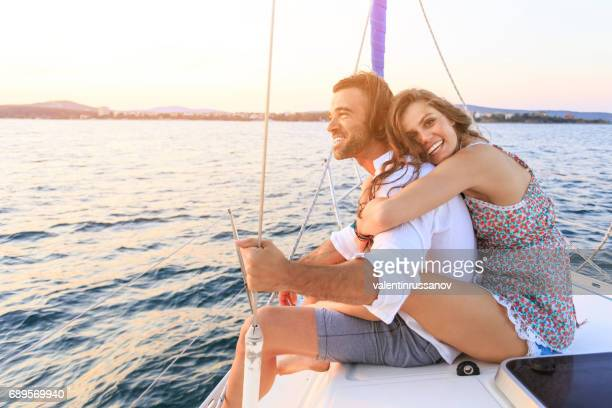 couple on honeymoon traveling with yacht - small boat stock pictures, royalty-free photos & images