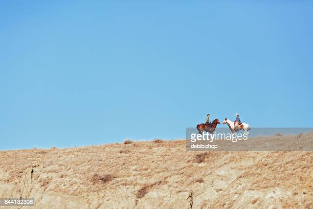 Couple On Horseback Facing Each Other