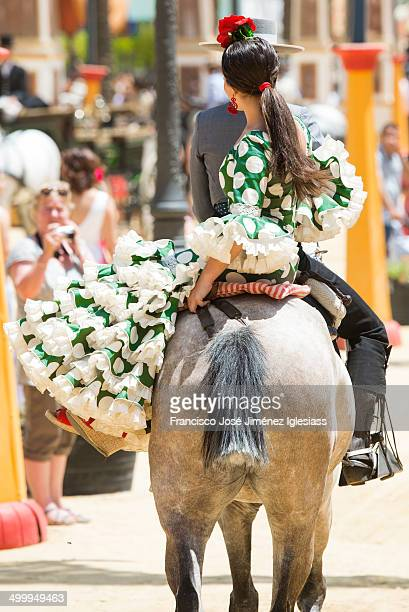 Couple on horseback with typical clothes andalusia, during the fair of Jerez de la Frontera.