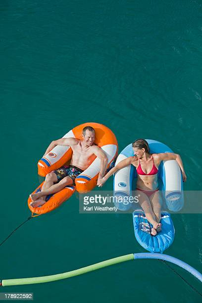 Couple on inflatable float