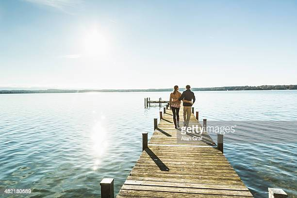 Couple on jetty, Lake Starnberg, Bavaria, Germany