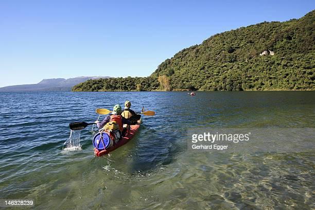 couple on kayaking expedition, lake tarawera - gerhard egger stock pictures, royalty-free photos & images
