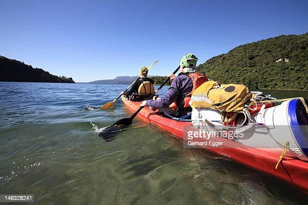Couple on kayaking expedition, Lake Tarawera