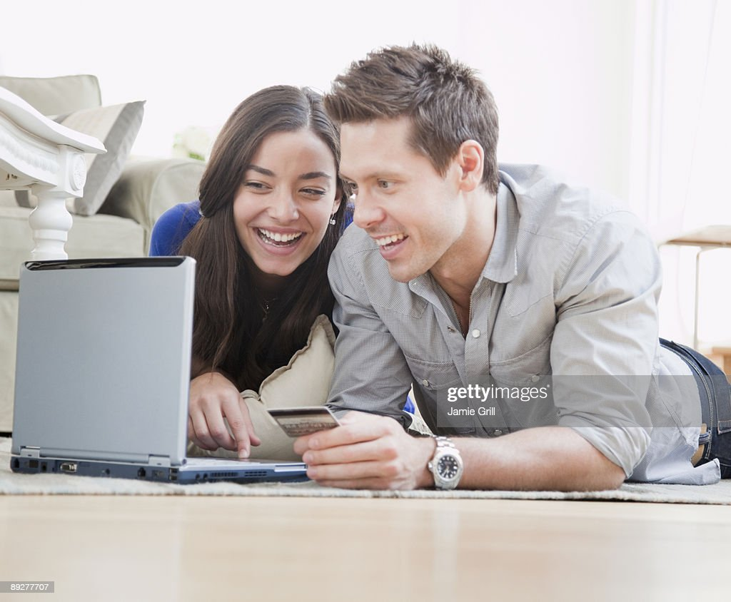 Couple on Laptop with Credit Card : Stock Photo