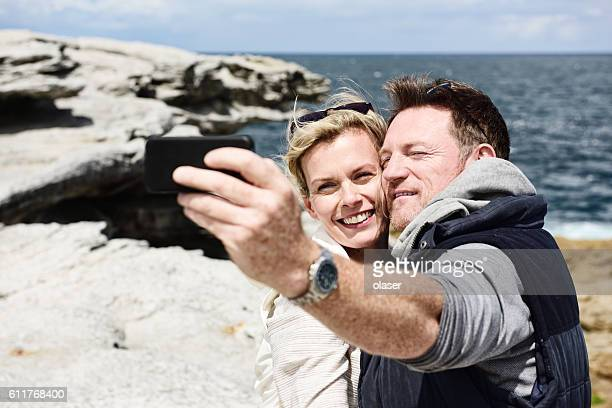 Couple on lookout, taking selfie