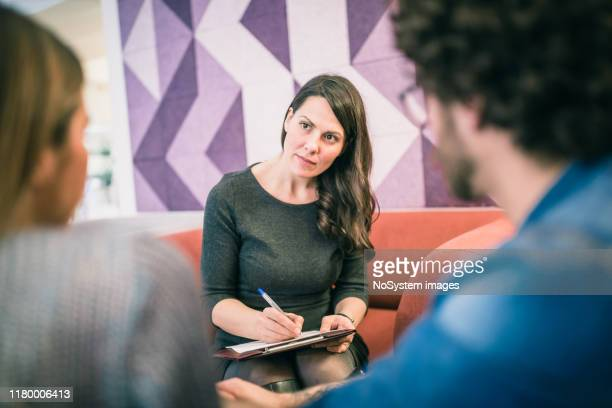 couple on meeting with counsellor - mental health professional stock pictures, royalty-free photos & images
