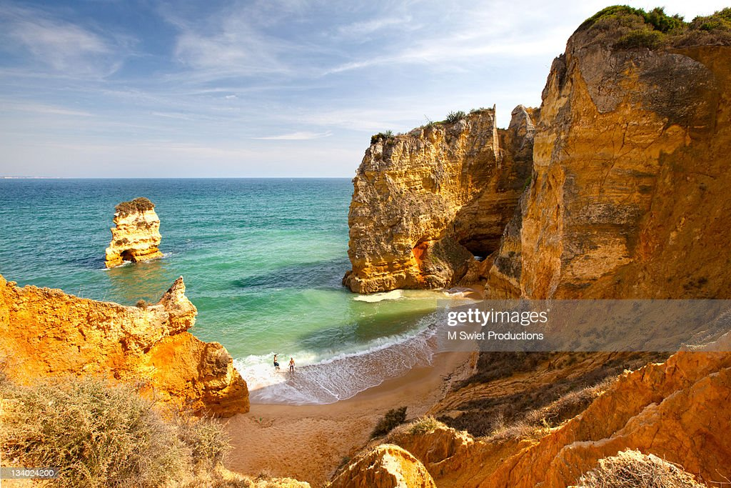 Couple on most beautiful famous beach in Portugal. : Stock Photo