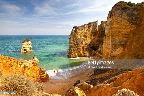 Couple on most beautiful famous beach in Portugal.