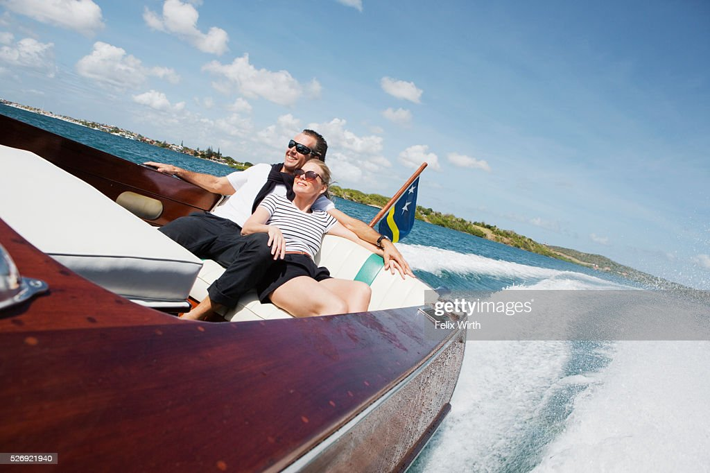 Couple on motorboat trip : ストックフォト