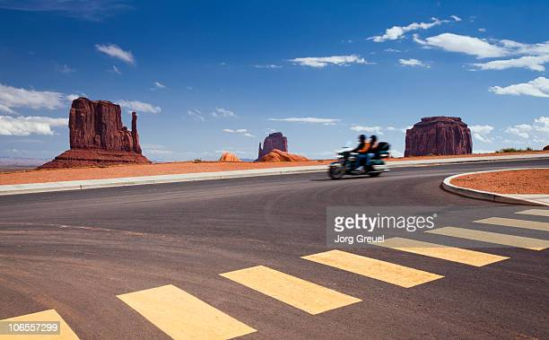 Couple on motorcycle in Monument Valley