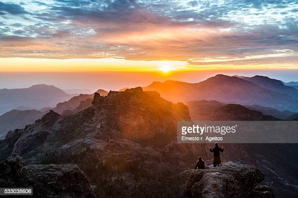 couple on mountain landscape at sunset - grand canary stock pictures, royalty-free photos & images