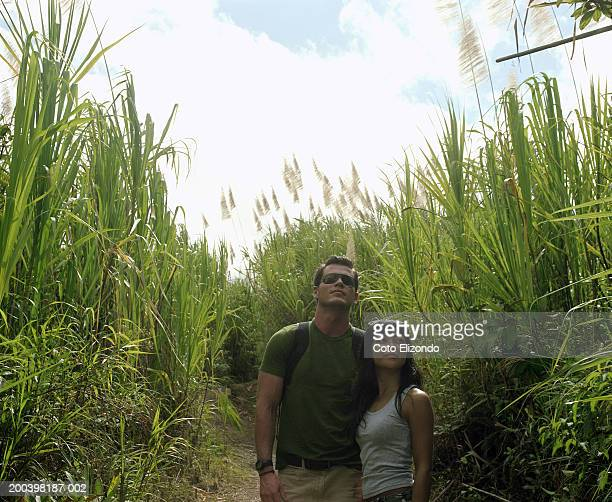Couple on path through tall grasses