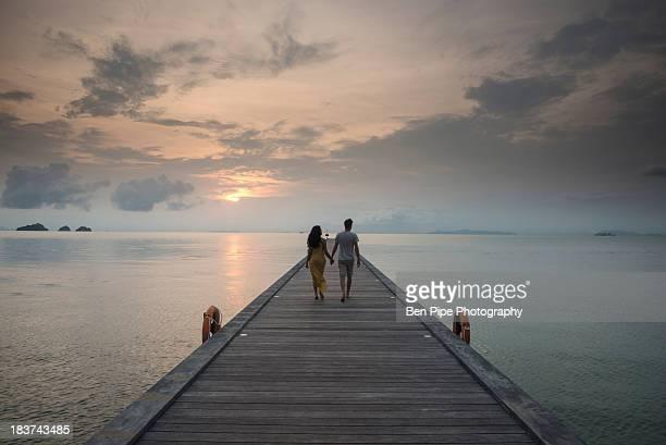 Couple on pier, Taling Ngam Beach, Ko Samui, Thailand