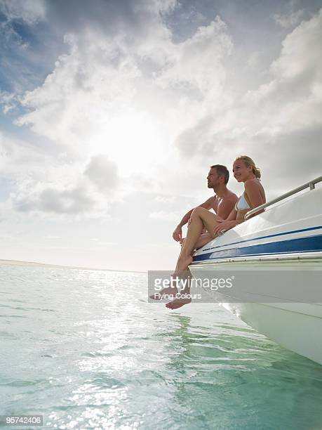 Couple on prow of boat looking out