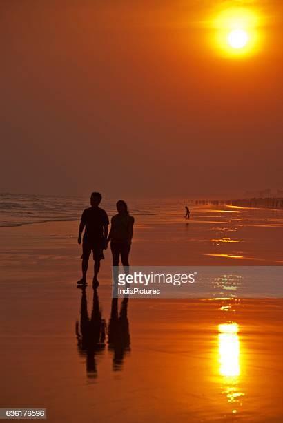 Couple on Puri Beach at sunset