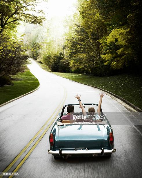 Couple on Roadtrip in Vintage Convertible Car