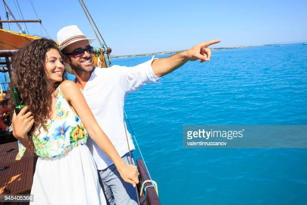 Couple on romantic trip with boat in the sea