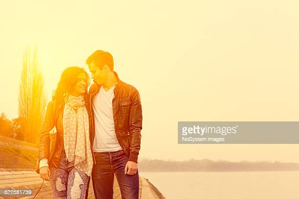 Couple on romantic walk by the river