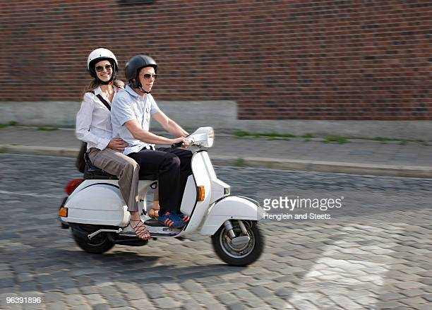 couple on scooter - motor scooter stock pictures, royalty-free photos & images