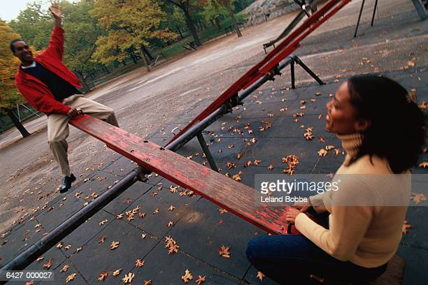 Couple on Seesaw