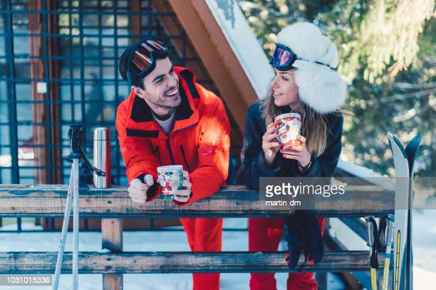 couple on ski holiday drinking hot tea - bulgaria stock pictures, royalty-free photos & images