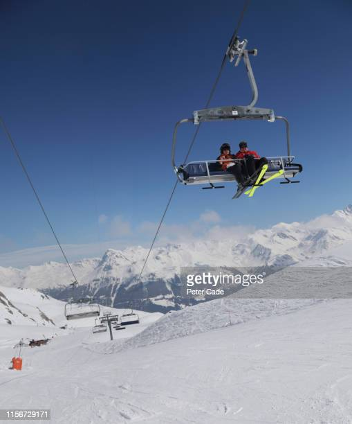 couple on ski lift - ski lift stock pictures, royalty-free photos & images