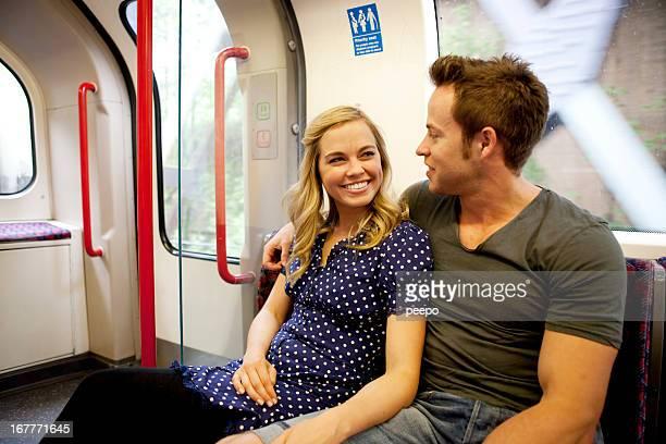 couple on subway train