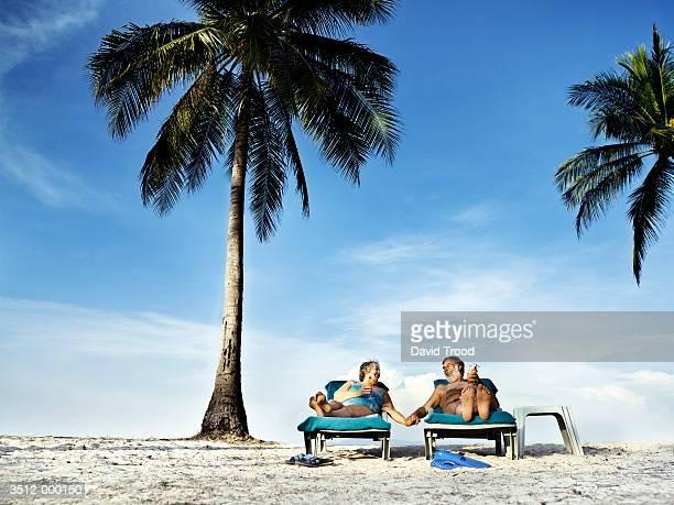 Couple on Sun Loungers