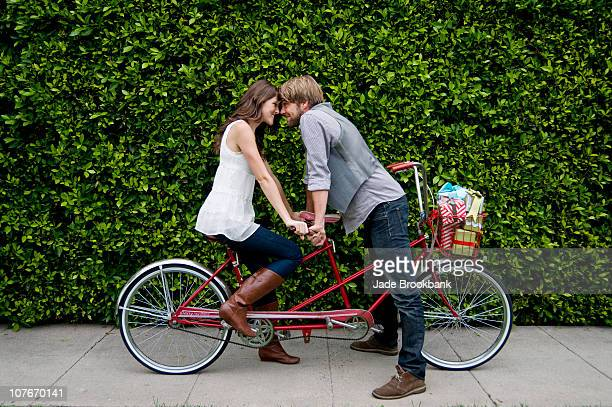 Couple on tandem bike looking at eachother