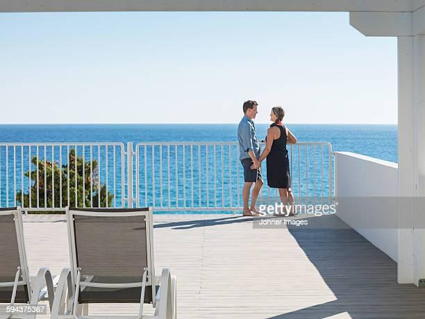 Couple on terrace at sea