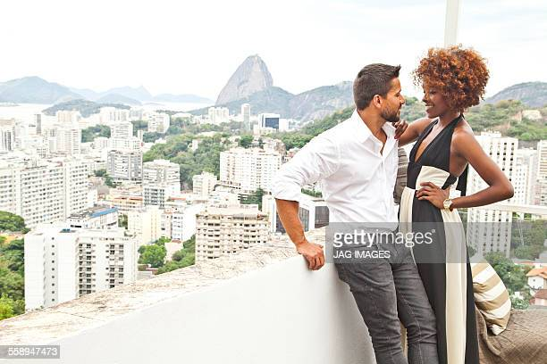 Couple on terrace, Sugarloaf Mountain in background, Rio, Brazil