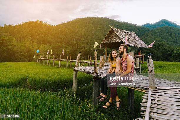 couple on the bamboo bridge near rice field - paddy field stock pictures, royalty-free photos & images