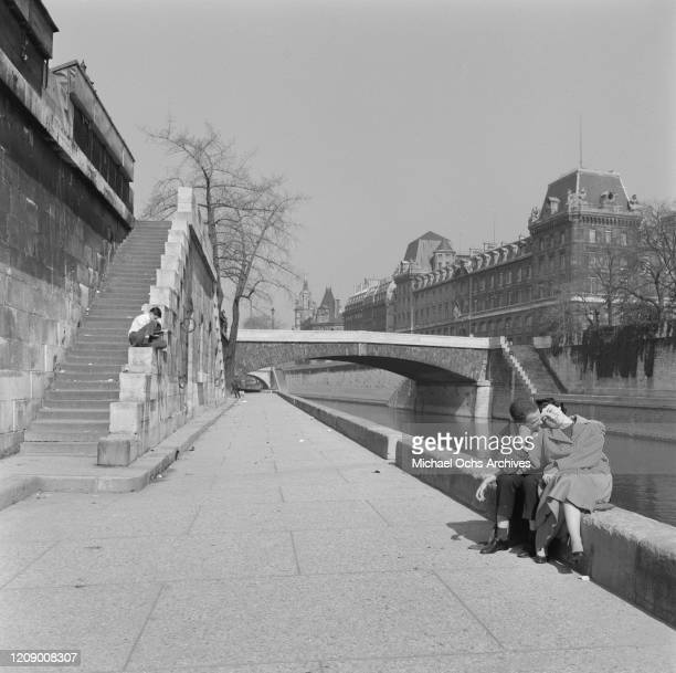 A couple on the banks of the River Seine in Paris France in the spring April 1958