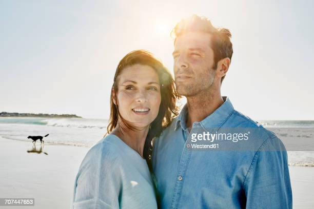 Couple on the beach at backlight