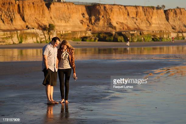 couple on the beach at low tide - carlsbad california stock pictures, royalty-free photos & images