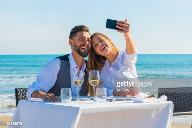 romantic dinner beach couple honey moon
