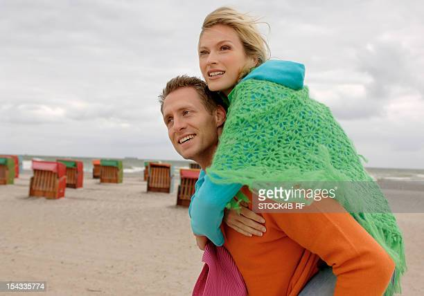 Couple on the beach under cloudy sky