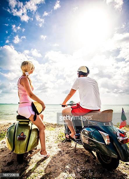 Couple on the beach with retro bikes