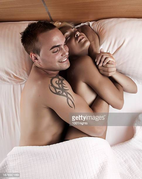 couple on the bed - male erection stock pictures, royalty-free photos & images