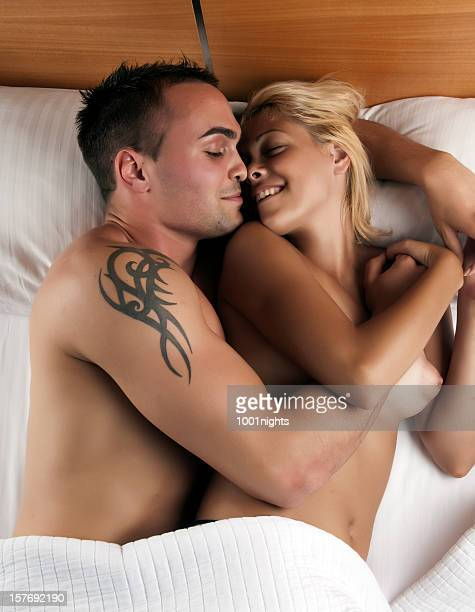 couple on the bed - male female nude stock pictures, royalty-free photos & images