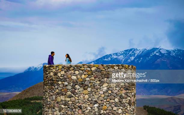 couple on the castle - madona stock photos and pictures